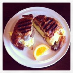 Croissant with Eggs, Provolone and Sausage